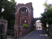 Exeter Castle gatehouse with County Court buildings in background